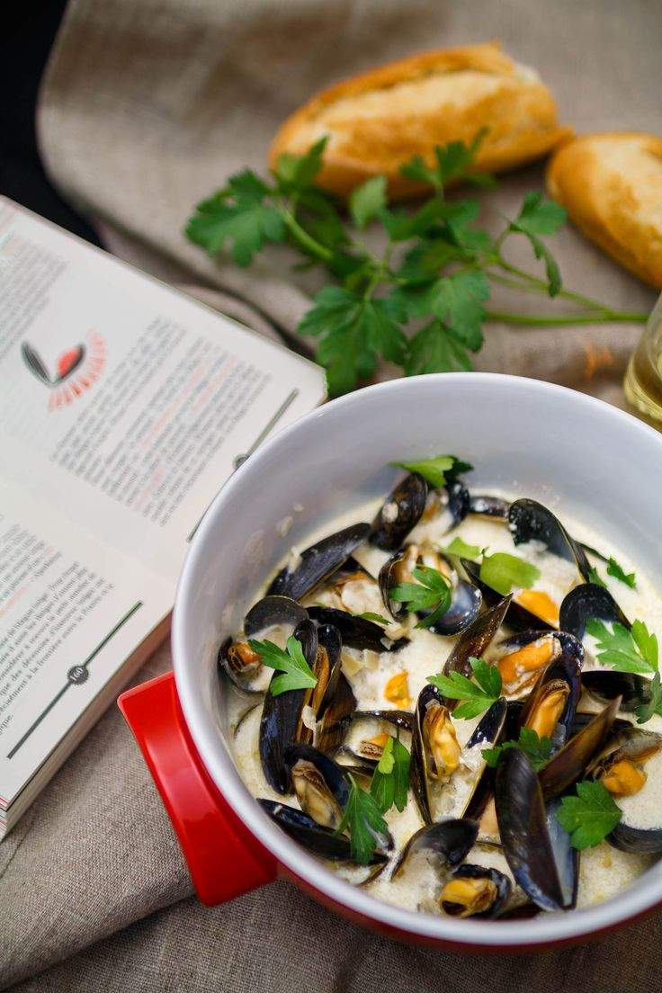 Mules in cider and cream. French seafood dish delicious with baguette.