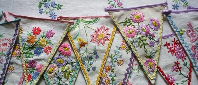 Bunting from vintage tablecloths. And the ric-rac just sets it off beautifully don't you think?