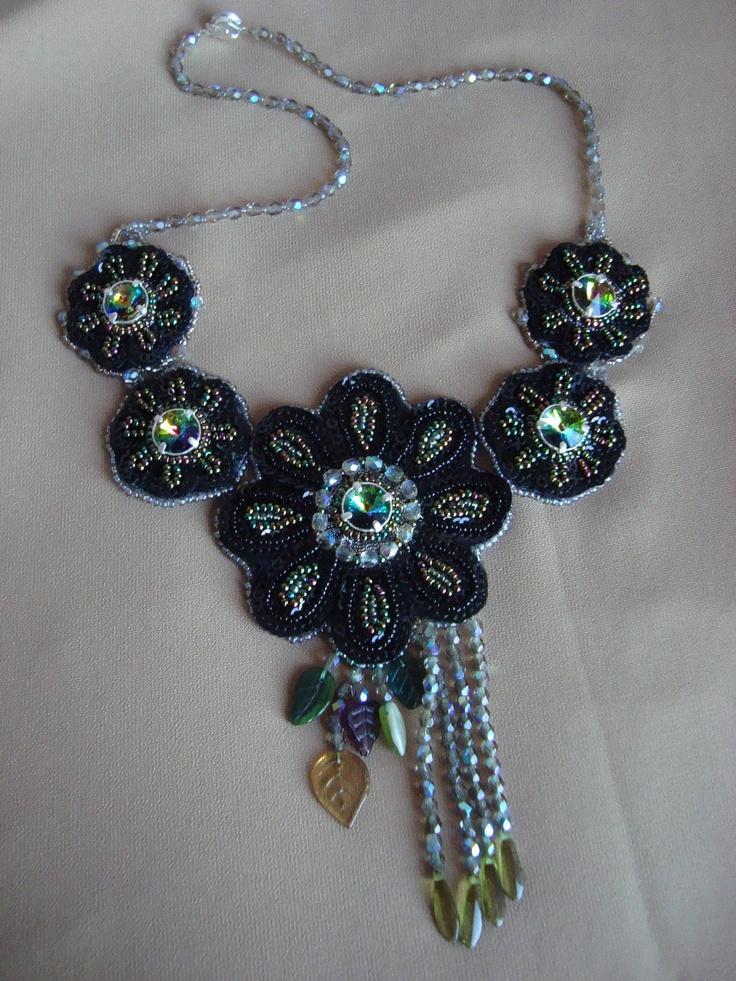 Adela Petcu_ The dark flowers_ with vitrail Swarovski ,sequins, cristals, Czech leaves and Toho beads