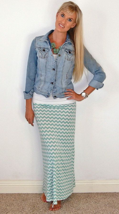 Patterned green maxi skirt, white top, denim jacket, green statement necklace. sandals.