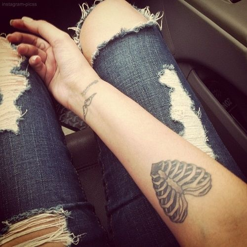 Love the size and placement...not the tattoo so much. I really want a forearm tattoo.