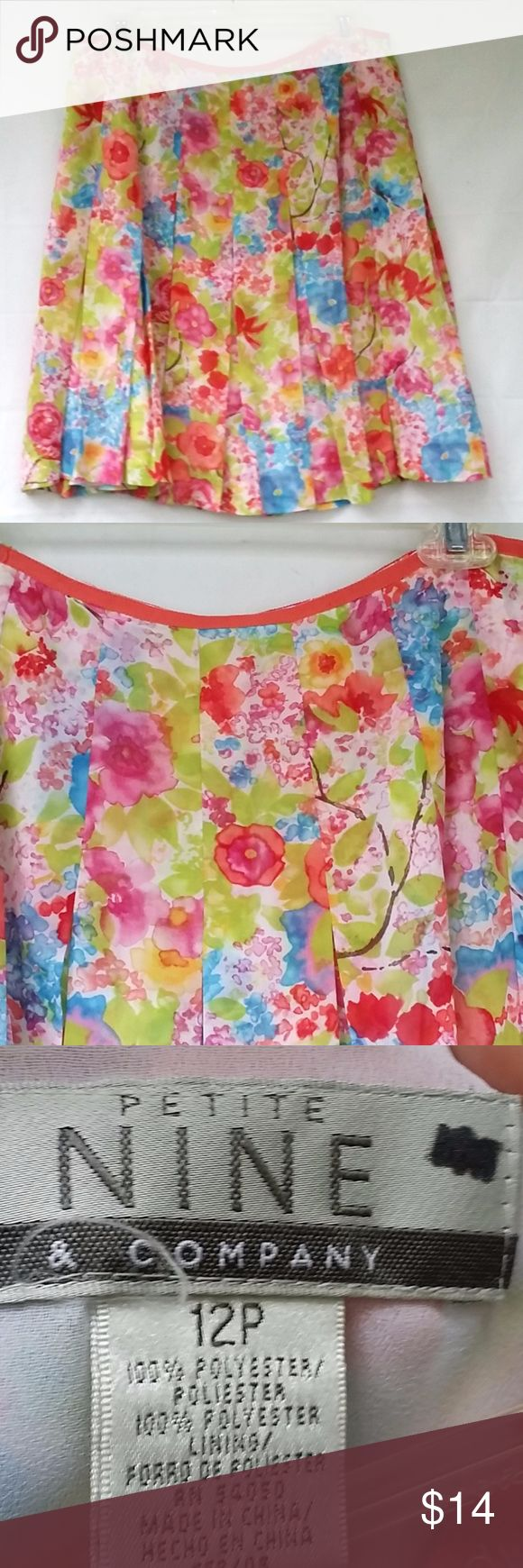 Nine Co Skirt 12 Petite Floral Print Pleated Nine & Co Nine West Women's Floral Print Pleated Career Skirt Size 12 Petite Gently used condition.  Has back zipper closure and lining.  Approx waist 30.5 and length 21 Multicolor Above knee Polyester Nine & Co. Skirts