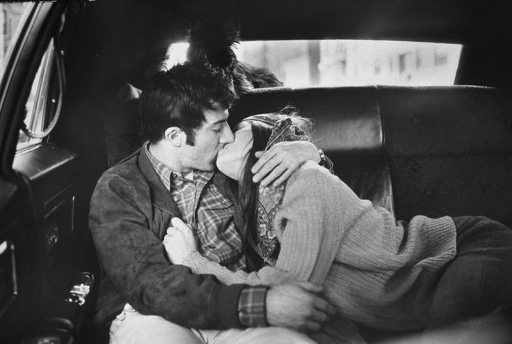 Dustin Hoffman kisses his wife, Anne Byrne, in the back of a taxi. New York, 1969.