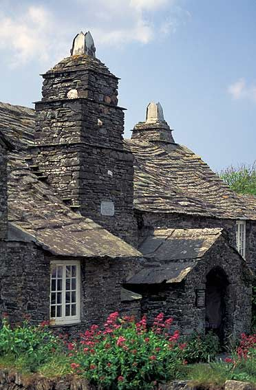 Tintagel Post Office, a National Trust property, Cornwall, England, UK - Tintagel Old Post Office is a 14th-century stone house, built to the plan of a medieval manor house. The house, and its surrounding cottage garden, are in the ownership of the National Trust.