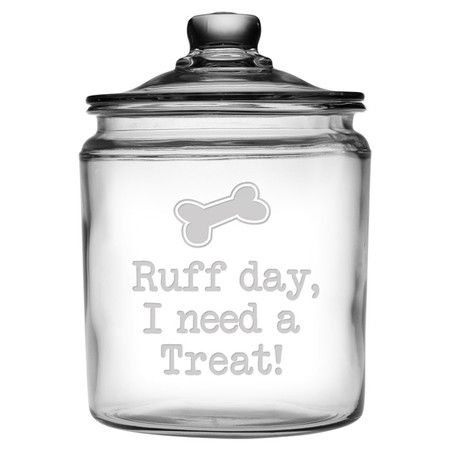 Perfect for stowing your four-legged friend's favorite treats, this charming glass jar showcases a sand-etched typographic and bone motif.