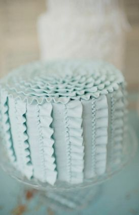 another buttercream cake decorating possibility...i like the more spaced out ruffles with the piping in the centers