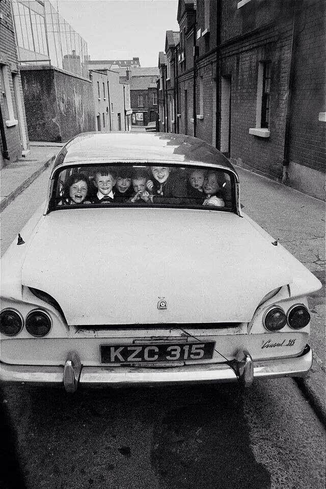 Old Dublin, it was the norm well into the 80s that if there was one child traveling there  would be as many as possible crammed in for the ride..