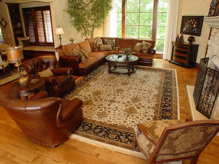 This Ivory Black Hand Knotted Wool Oriental Area Rug Pairs Perfectly With The Leather Furniture And Suble Accents Through Out Room