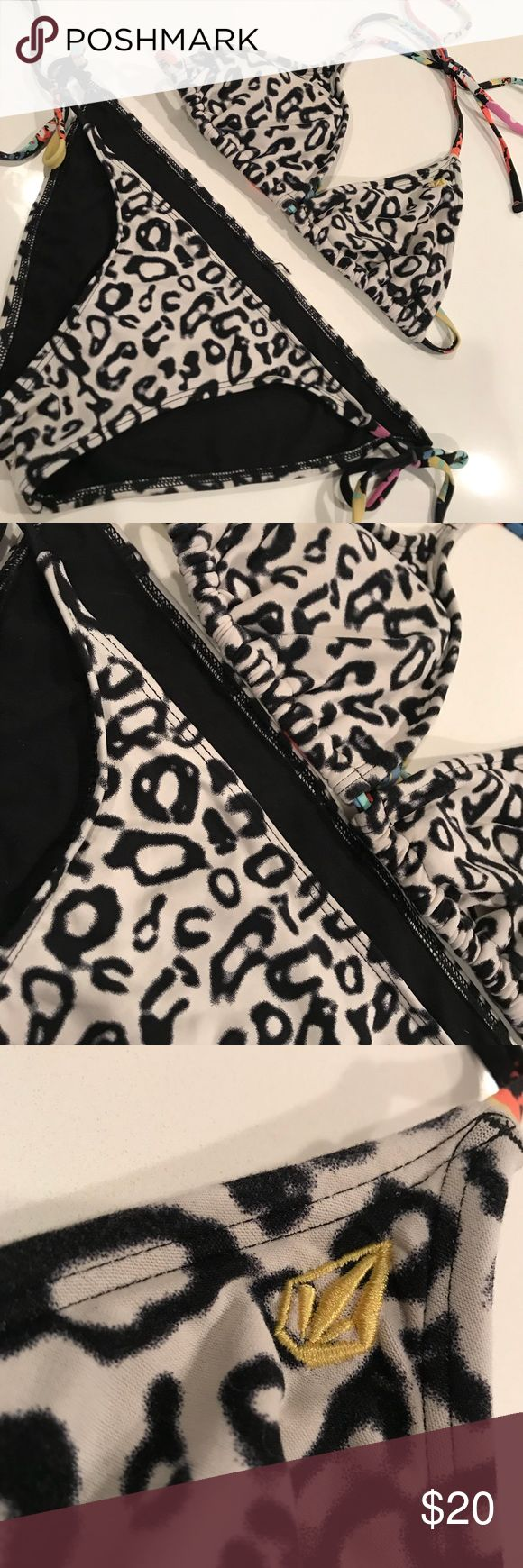 Volcom Leopard Print Bikini Set! Women's black and white with colorful strings, Volcom Bikini Set! Includes both pieces: triangle bikini top and bottoms that tie on the side so you're  able to adjust to the most comfortable fit! Both are size small and worn lightly with no major flaws ! Lots of life left! Volcom Swim Bikinis