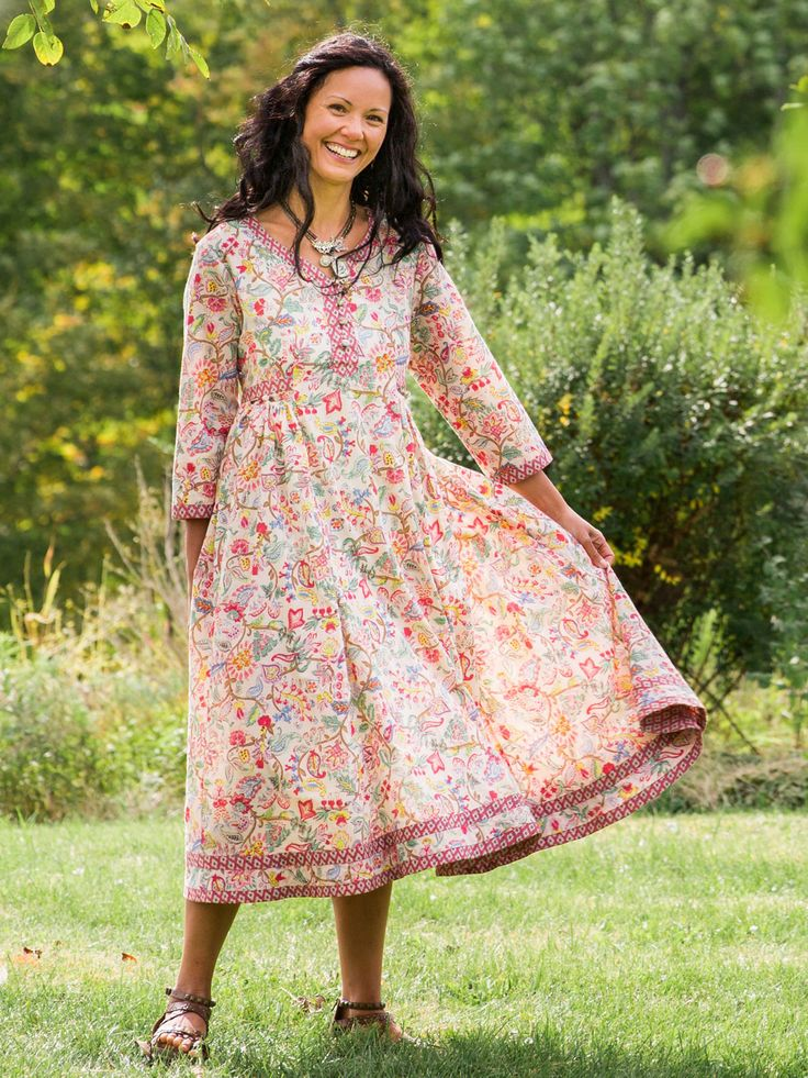 Vivacious and 1970s-inspired, our charming, floral Nostalgia dress features a sweetheart neckline with a contrasting, geometric print trim.  This piping repeats on edge of the collar and sleeves, and on the double hemline. Tiny gathers below the waist give the skirt an easy, flattering flow.
