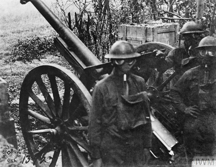 © IWM (Q 69550) Gun crew of a French 75mm gun (American 12th Battery, 12th Field Artillery Regiment) wearing gas masks. Bois de Belleau, 30 June 1918. The battle for Belleau Wood raged from 1 - 26 June, so the Yanks are pressing their advantage.