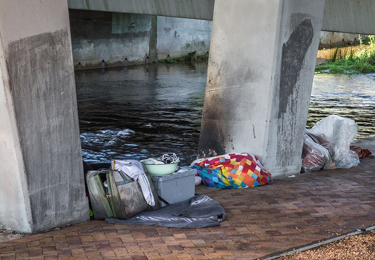 Homeless. Sleeping under a highway bridge