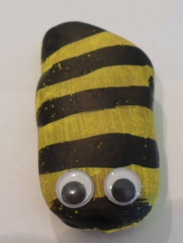 Stone painted as a bee.