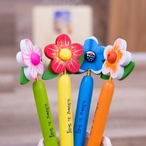 Colored pencils with flowers and message ~ Isus te iubeste
