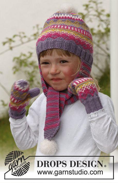 Fideli / DROPS Children 23-42 - Moufles jacquard DROPS en Merino Extra Fineet bonnet jacquard DROPS avec longs cache-oreilles, en Merino Extra Fine avec pompons en Symphony. Du 3 au 12 ans.
