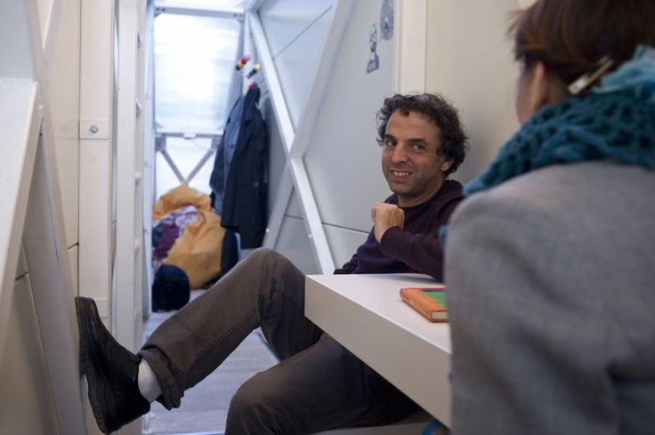 On the first floor, the living room is quite cramped, as demonstrated by Etgar Keret's squashed leg.