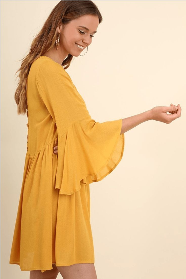 This gorgeous yellow dress is perfect for enjoying your weekends in, date night or even to wear to the office. We love to chic boho feel of the dress with an edge of street style. This yellow dress is perfect for a party dress, night dress, fall dress, casual dress, summer dress, spring dress,  winter dress, or work dress. This dress looks great paired with wedges, booties, boots or flats. This yellow dress is the perfect mustard yellow dress and sure to be a must have color of the season!