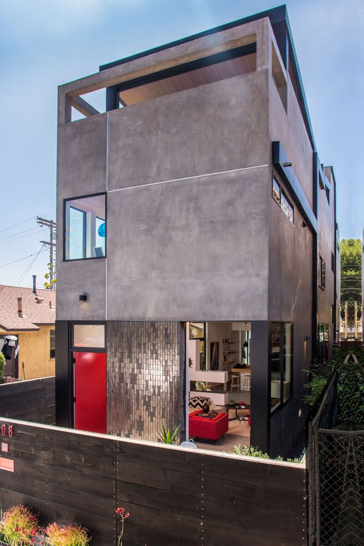 A new home clad in dark stucco and tile arrives in los for American home design los angeles