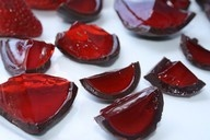 Rasberry jello shots in chocolate shell.