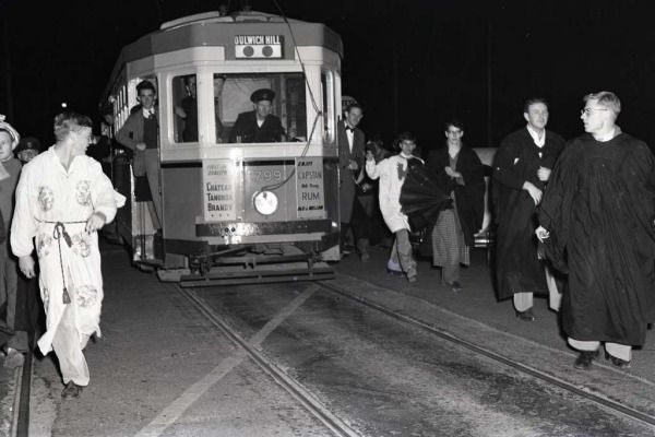 University students hold up the last Dulwich Hill tram on City Road in September 1957.