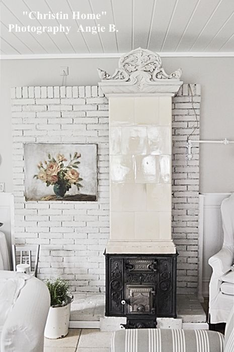 Okay, I LOVE the fireplace. I love how it's an old stove with a chimney ontop of it. Old and new. But I could NEVER live in an all white house.