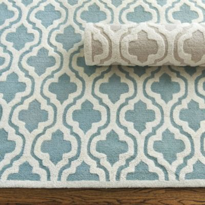 We love geometrics everywhere from fabrics to rugs to give our rooms a sophisticated global flair. Our Moroccan Trellis Rug is hand tufted in a plush high/low trellis of 100% wool and cotton canvas backed for added durability. Moroccan Trellis Rug features: Rug pad recommendedSwatches availableImported