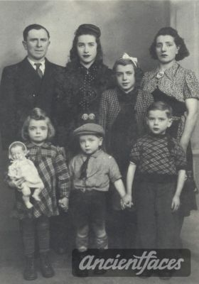 Photo taken before deportation. Suzanne Lederman *standing behind her younger siblings* was deported to Auschwitz in 1942 at age 12.