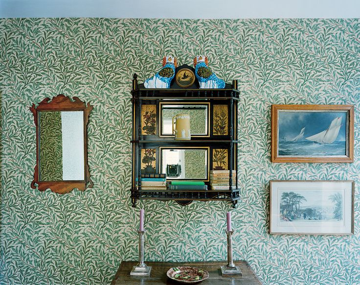 Designer Ben Pentreath's London apartment: Ceramic Staffordshire dogs by the artist Rob Ryan on an Aesthetic Movement shelf. The wallpaper is William Morris.