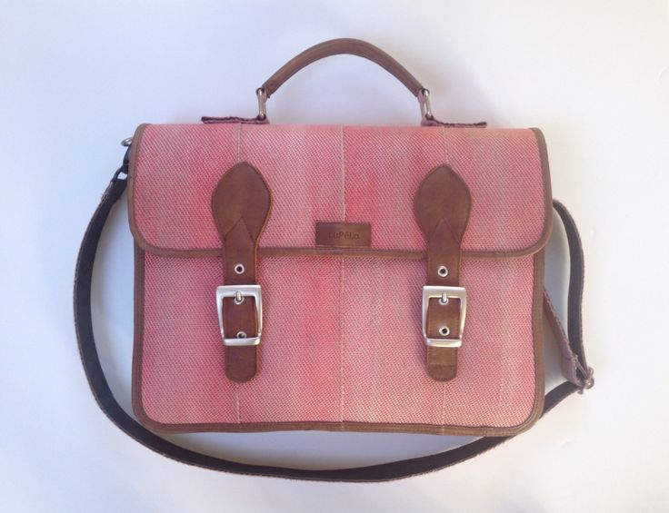 Workbag, made of used fire hose and brown leather. Lined with leather.