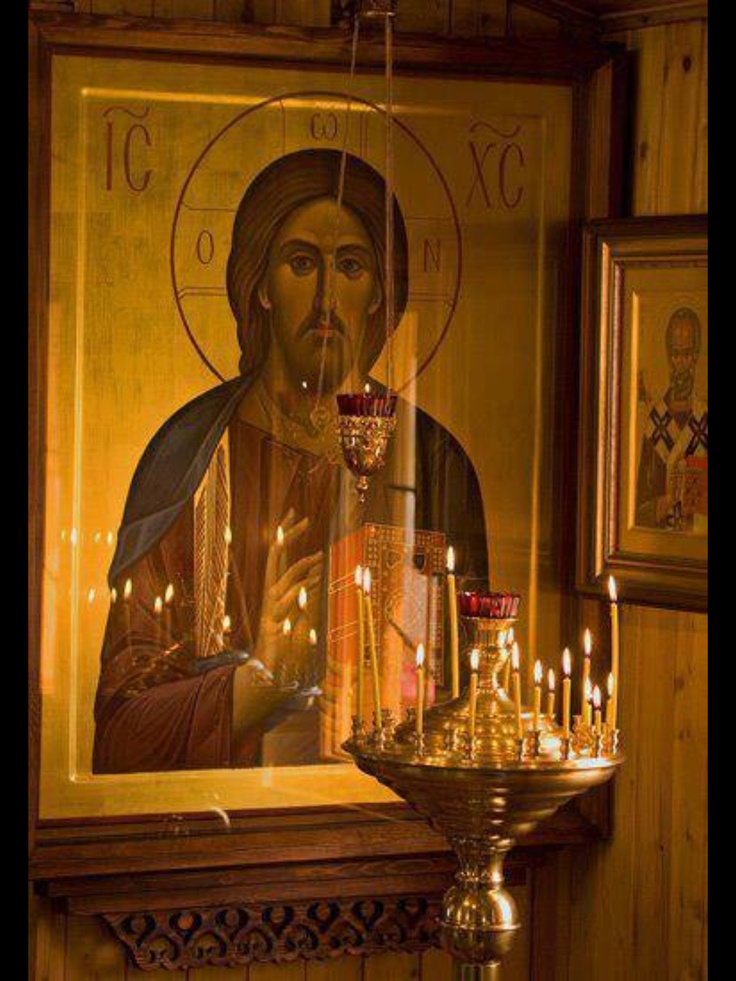 Worshipping in front of the icon of Christ