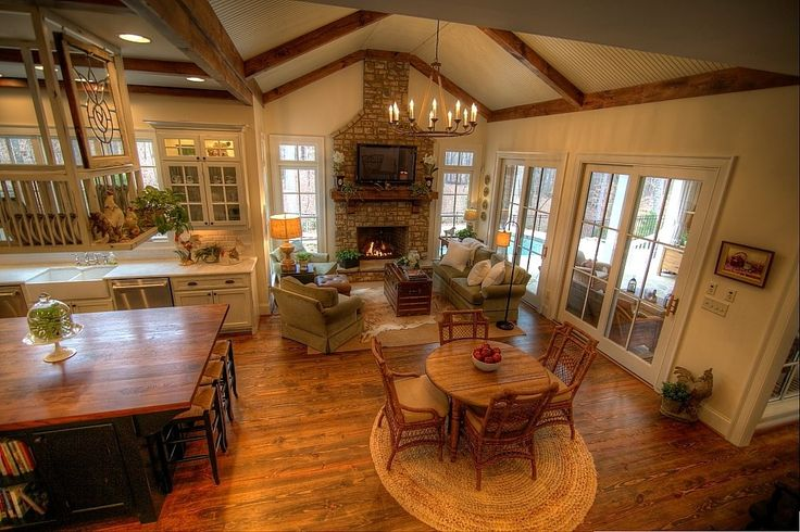 Country great room with wood countertop stone fireplace for Vaulted ceiling great room