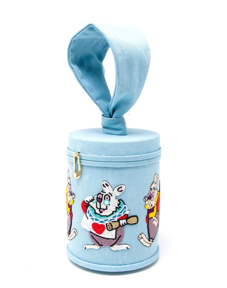 This light blue Olympia Le-Tan embroidered canvas 'White Rabbit' cylinder handbag showcases the innovative designer's love of literature. Part of her Disney-inspired 'Down the Rabbit Hole' Resort 2016 collection, the piece is beaded with an iconic character from the original Alice in Wonderland novel. Expertly crafted in Italy on a brass frame, the structured piece can be worn using the removable cross body strap or wrislet for hand carry.