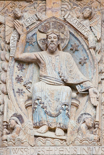 """Medieval """"Christ in Majesty"""" front tympanum of the church of Ste. Foy, Conquest, Aveyron, France.  Shows traces of original paint."""