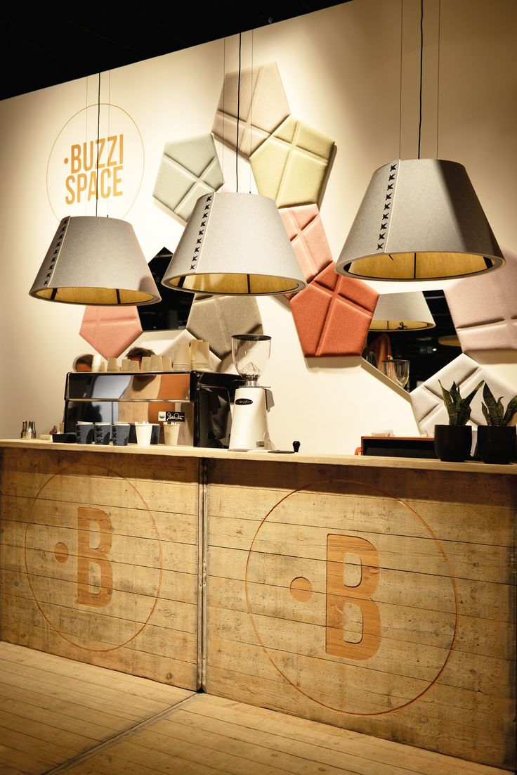 An oversized lamp which combines lighting with acoustic insulation, privacy  and design.