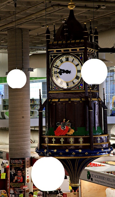 """""""Clock of the Charging Horsemen""""   The clock features a round Norman tower, & four jousting knights at the base modeled after a clock at Wells Cathedral in England. Located in downtown Hamilton, Ontario Canada"""