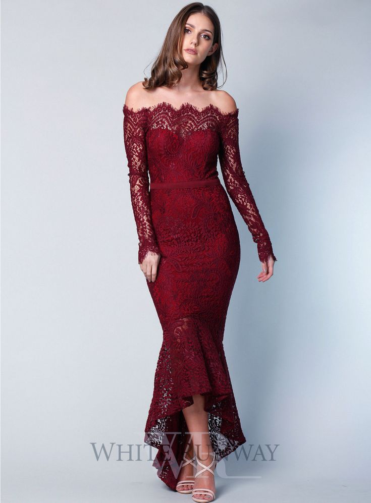 A stunning midi length dress by Elle Zeitoune. A lace off-shoulder style  featuring long sleeves and frill hemline.