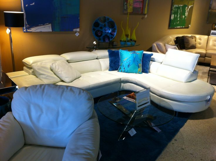 The peacock pillows are a perfect accent against the white leather sectional.