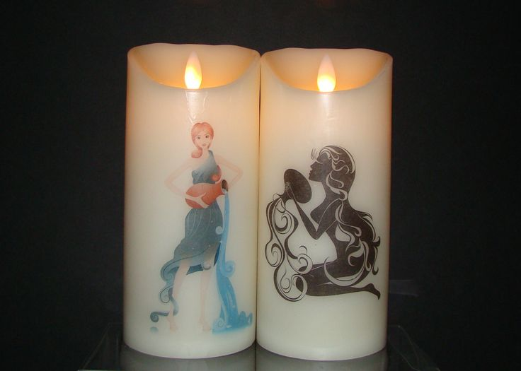 Aquarius January 21 ~ February 19  Beautiful flameless pillar candles adorned with Lady Aquarius and the Water Bearer.