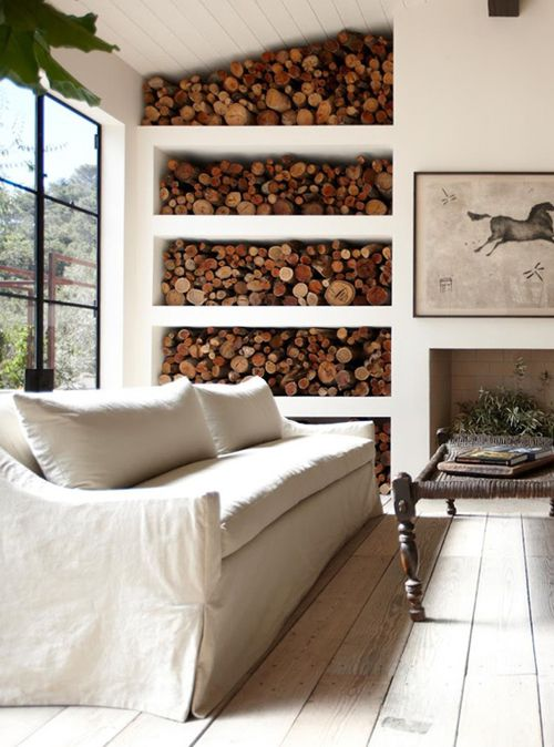 Logs logs logs!! Love the way the shelves flow into the chimney!