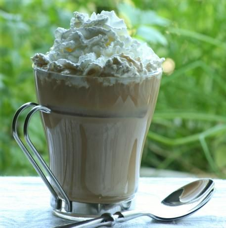 Nutty African (Coffee Drink) 3/4 ounce Amarula cream liqueur 3/4 ounce Frangelico 4 ounces fresh brewed coffee whipped cream (topping) finely chopped nuts, topping (optional)