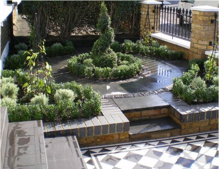 I like the mixture of greenery with the hard surfaced tile for Formal front garden ideas