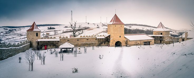 "This shot was captured a couple of minutes after I entered into the old medieval citadel of Rupea. This area is called the Dawn fortress and right under the middle defense tower is the main entrance into the citadel. When we visited this place last year in December, outside was pretty cold and the entire landscape … Continue reading ""Panoramic View Of The Dawn Fortress"""