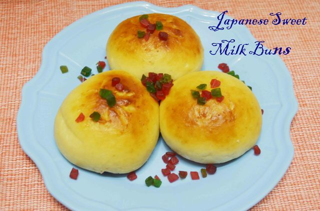 Japanese Sweet Stuffed Milk Bun/ Sweet buns using Tangzhong You don't need anything else to enjoy these #sweetbun #Japanese #milkbuns #sofy #fluffy #fruitjam #tuttifruity Recipe at: www.annapurnaz.in