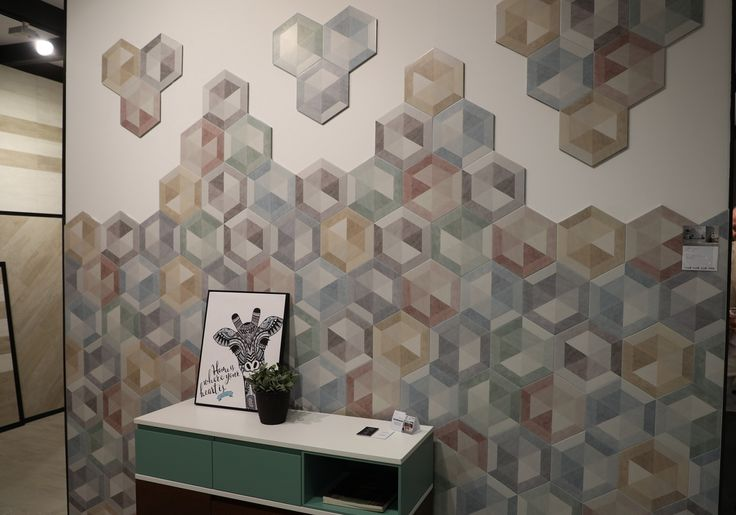 Azteca experiments with hexagonal shape and makes the colors play (Funny).