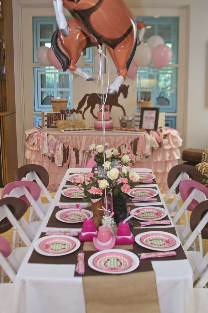 Decorated table at a cowgirl birthday party! See more party ideas at CatchMyParty.com!