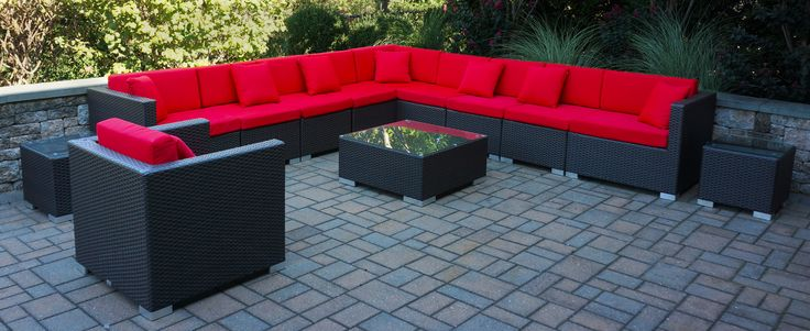 BFM seating Aruba outdoor sofa sectional with Sunbralla cushions look amazing in this brick paver space.