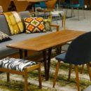 Danskt soffbord i teak, Kurt Østervig för Jason Møbler. V-formade ben samt tidningshylla i rotting.  154x53,5x50 cm