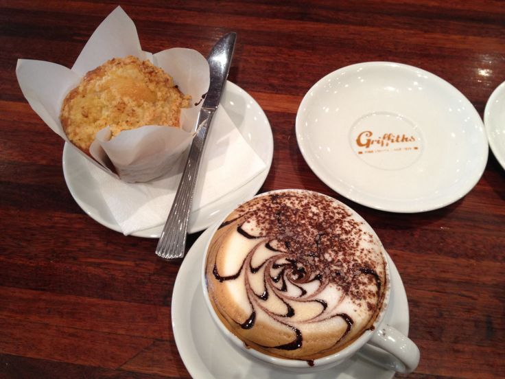 Coffee art: this is a mocha with a nice apple crumble muffin :)   Tea time anyone?   Love playing around with chocolate sauce!!!   Poured by me :)
