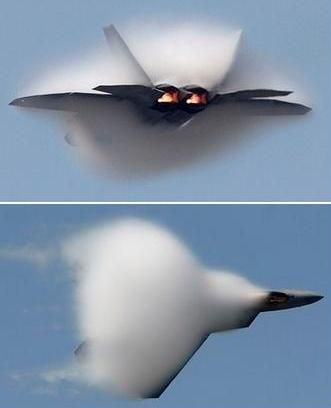 F22 goes transonic in a cloud. Literally.The plane's near-supersonic speed changes the temperature and pressure of the air around it, causing ambient moisture to condense. Clouds naturally follow.