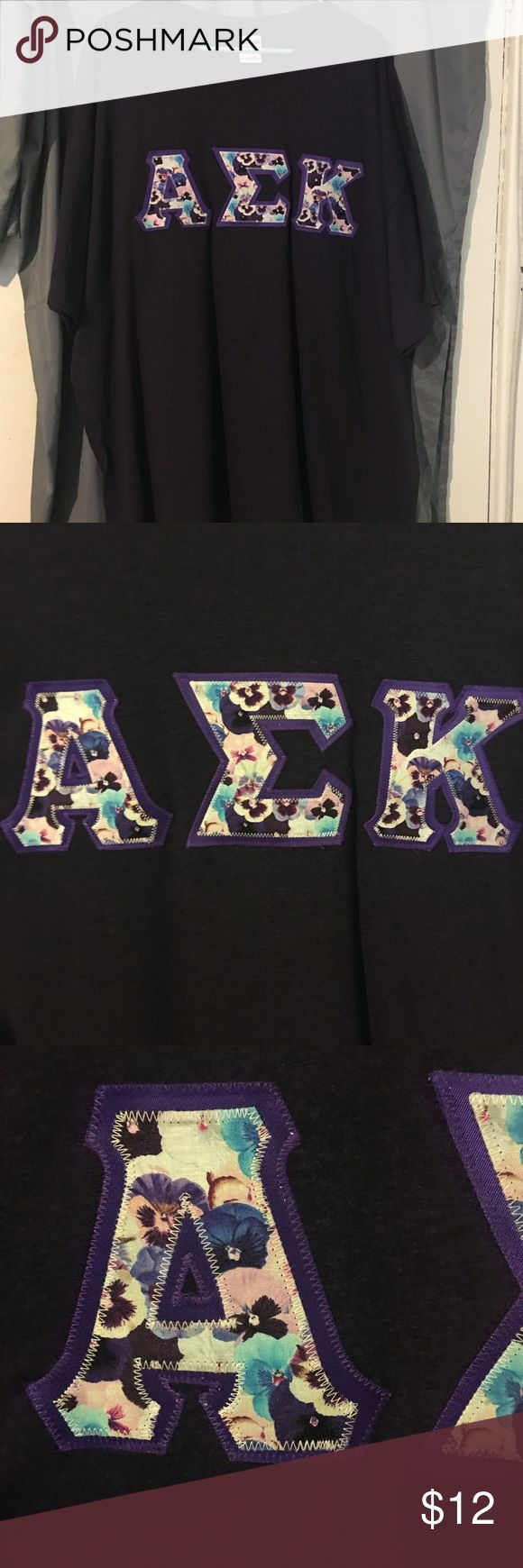 Alpha Sigma Kappa T-shirt - Violets I left a sorority, and can not wear their letters anymore. The chapter on my campus only has a few people, and I'm unable to sell the shirts to them. This is a dark purple/blackberry  Gildan t-shirt, purple border, and a violet flower pattern for the letters. In perfect condition, and has only been worn a handful of times. (I ordered it from the Something Greek website, and the pattern is no longer available.) Gildan Tops Tees - Short Sleeve